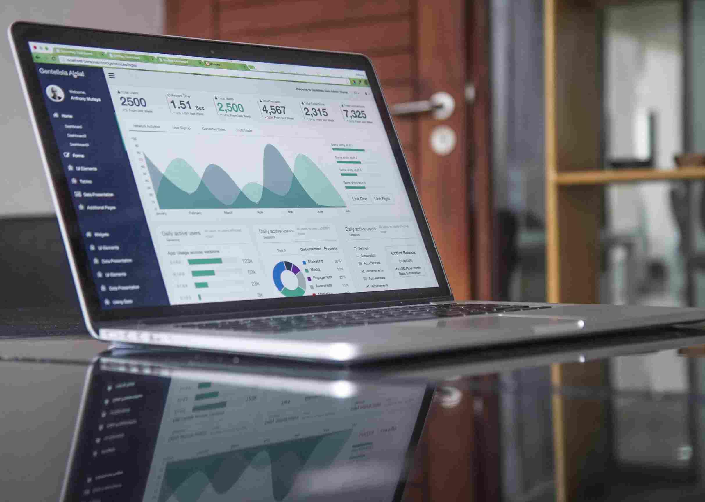 Image of a laptop showing algorithms